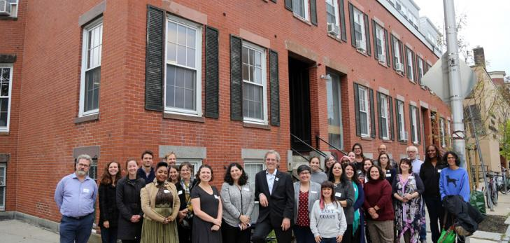 Photo of the tenants at 93-99 Bishop Allen Drive in front of the building's brick facade